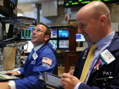 Traders were a little happier Tuesday as the Dow Jones industrial average gained more than 400 points.