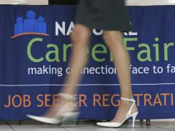 An applicant enters an Aug. 4 job fair in Arlington, Va.