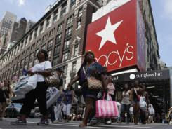 Shoppers pass Macy's  department store on Aug. 4, 2011, in New York.