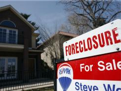 A foreclosure sign in April 2010 in Denver.