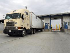 A truck passes from Mexico into the U.S. May 6 at an inspection point on the World Trade Bridge in Laredo, Texas.