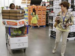 Shoppers Leslie Corridon, left, and Leslie Christon walks the aisles at a Sam's Club store in Rogers, Ark., on June 2, 2011.