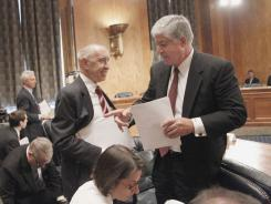AIG CEO Robert Benmosche, right, in May 2010 after testifying before the Senate Congressional Oversight Panel.