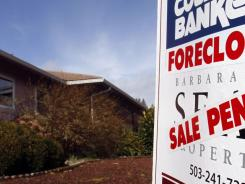 A foreclosed house with a sale pending sign is shown in Tigard, Ore., on March, 8, 2011.