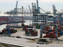 Shipping containers at the Port of Long Beach, Calif., await export in this file photo.