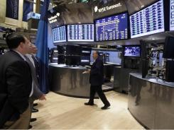 Traders preview a redesigned trading post on the floor of the New York Stock Exchange, Friday, Aug. 12, 2011.