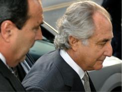 Bernard Madoff, center, arrives at a U.S. Federal Court on March 12, 2009.