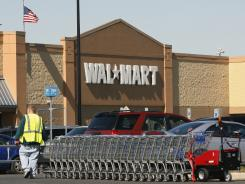 A worker gathers shopping carts near a Walmart store in Washington Township, N.J. in this file photo.