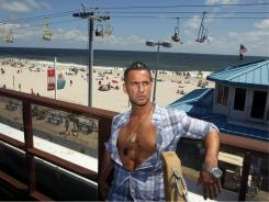 "Mike ""The Situation"" Sorrentino, of MTV's ""Jersey Shore"" stands on a deck overlooking the boardwalk and beach at Seaside Heights, N.J."