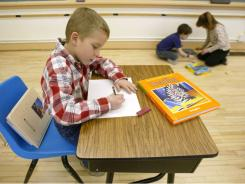 A 2nd-grade student at his desk at an elementary school in Montana.