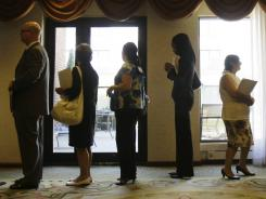 Job seekers stand in line to enter a job fair in Independence, Ohio.