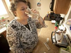 Judy Ariba takes an assortment of medications daily at her Siloam Springs, Ark., home.