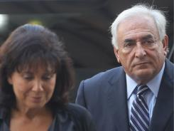 Former International Monetary Fund director Dominique Strauss-Kahn enters Manhattan State Supreme Court with his wife Anne Sinclair on Tuesday in New York City.