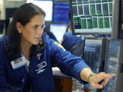 Jennifer Klesaris of Barclays Capital works on the floor of the New York Stock Exchange, Tuesday, Aug. 23, 2011.