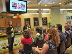 "Wellness Club lecturers Heather Hardy, left, and Michaele Kruger teach the ""Four Pillars of Healthy Eating"" at a Whole Foods in Dedham, Mass."
