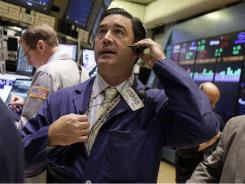 Trader Patrick Forbes works on the floor of the New York Stock Exchange Thursday, Aug. 25, 2011.