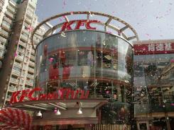 Confetti is part of the celebration of the 2005 opening of a Kentucky Fried Chicken in Shanghai.
