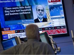 A trader on the floor of the New York Stock Exchange watches a monitor after Federal Reserve Chairman Ben Bernanke's speech on Friday, Aug. 26, 2011.