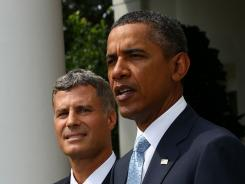 President Barack Obama introduces Alan Krueger in the Rose Garden of the White House August 29, 2011.
