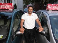Driving school owner Rajendra Hariprashad pays off credit cards at the end of the month and pays extra on his mortgage.