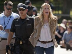 Actress Daryl Hannah is arrested Tuesday by U.S. Park Police in front of the White House.