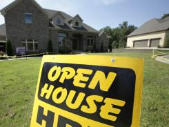 "An ""Open House"" sign is in front of a new home for sale in Little Rock, Ark. on Aug. 22, 2011."