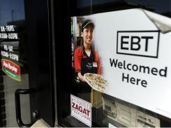 A sign outside Papa Murphy's tells customers that EBT can be used at the store in Sioux Falls, S.D.