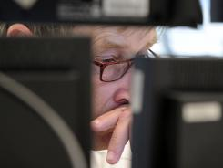 A stock trader watches trading at the exchange in Frankfurt Sept. 9, 2011. German stocks dropped more than 4%.