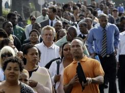 In this Aug. 31, 2011 file photo, people wait to enter a job fair at Crenshaw Christian Center in South Los Angeles.