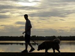 Mike Cantone runs with his dog Rocky inside Orlando's Baldwin Park.