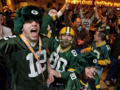Green Bay Packers fans celebrate at the Stadium View Bar near Lambeau Field after the Packers won Super Bowl XLV. The NFL supports thousands of businesses.