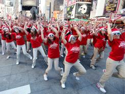 Dancers gathered in Times Square to perform a choreographed routine to promote The Radio City Christmas Spectacular's annual Christmas show on  August 11.