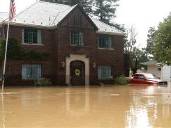 A home in West Pittston, Pa., takes on water from the Susquehanna River as widespread flooding brought on by the remnants of Tropical Storm Lee caused extensive damage.