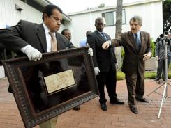 "From left, L.A. Sheriff officials Estevan Martinez, Clarence Williams and Steve Whitmore display the recovered Rembrandt drawing, ""The Judgment."""