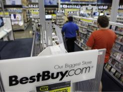 A Best Buy employee helps a customer at a store in Mountain View, Calif., Sept. 12, 2011.
