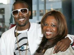 "Kanye West (left) and his mother Donda West attend a book signing for her book ""Raising Kanye: Life Lessons from the Mother of a Hip-Hop Superstar"" in Los Angeles. She died following surgery in 2007 by a plastic surgeon who was not board-certified."