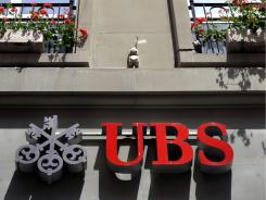 UBS revealed an estimated loss of $2 billion after the discovery of unauthorized trading at its investment bank.