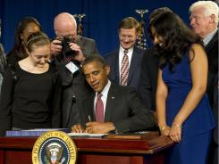 President Obama signs the new patent law at Thomas Jefferson High School for Science and Technology in Alexandria, Va.