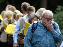 Jay Kober, 60,  who has been unemployed for 10 months, waits in line during the Maximum Connections Job and Career Fair in Portland, Ore., Sept. 15, 2011.