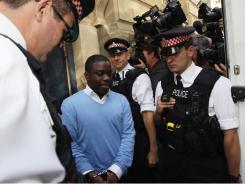 UBS trader Kweku Adoboli leaves the City of London Magistrates court on Friday.