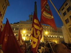 Demonstrators gather during a protest against the government's austerity measures in front of the Italian Parliament, in Rome Sept. 7.