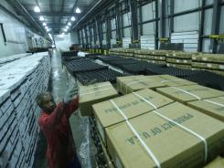 Claude Washington stacks frozen chicken in a cold storage unit at the Port of New Orleans in this file photo.