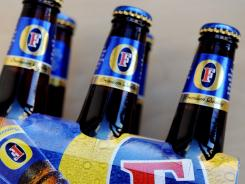 This file photo shows a six-pack of Fosters lager bottles in Sydney.