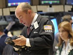 A trader works on the floor of the New York Stock Exchange, Sept. 22, 2011.