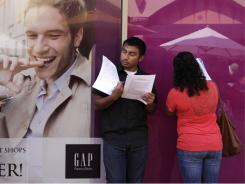 Job seekers fill out applications during a job fair at the Citadel Outlets in Commerce, Calif., Sept. 21, 2011.