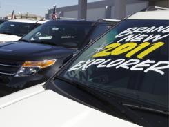 Ford Explorers sit at a car dealership in San Jose, Calif., as consumers remain reluctant to spend on big-ticket items.