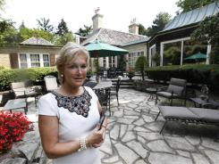 Ronni Keating waits for a client to view a home in Bloomfield Hills, Mich., Aug. 23, 2011.
