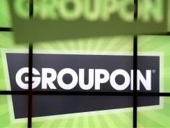 Groupon signage is displayed at company headquarters in Chicago, Illinois.