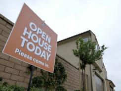 An open house sign near new homes in the Blackstone development in Brea, Calif.