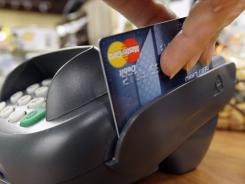 Banks that charge customers fees to use debit cards for purchases may be on the rise.